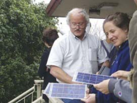 Joe Jordan with students and solar panels at Cabrillo College, Santa Cruz